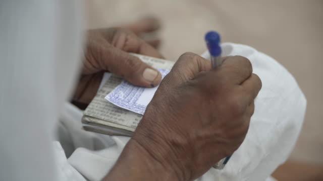 C/U man hands writing, India