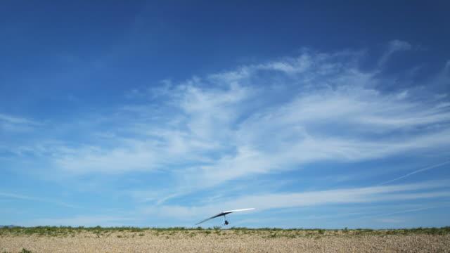 ws pan pov man hang gliding / lehi, utah, usa. - hang gliding stock videos and b-roll footage