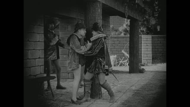1572 a man has a brief moment with an acquaintance - 1916年点の映像素材/bロール