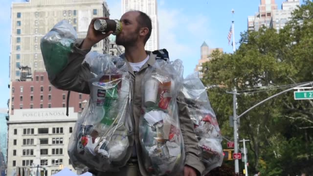 A man has been strolling around New York for two weeks weighed down with trash