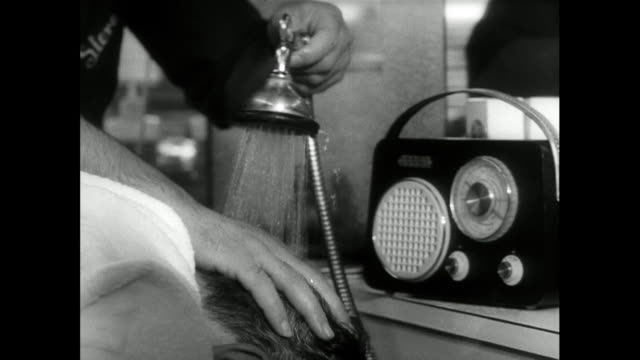 man has hair washed over sink with radio; 1963 - barber stock videos & royalty-free footage