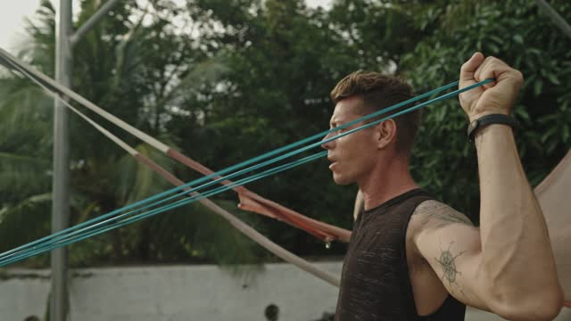 man has training with resistance band - one mid adult man only stock videos & royalty-free footage