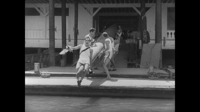 1927 man (buster keaton) has trouble taking on the role of rowing captain - sculling stock videos & royalty-free footage