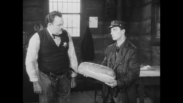 1928 a man (buster keaton) hatches a plot to break other man (ernest torrence) out of prison - sulking stock videos & royalty-free footage