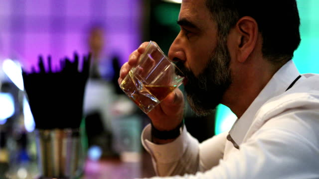 man having a drink in a bar. - alcohol abuse stock videos & royalty-free footage