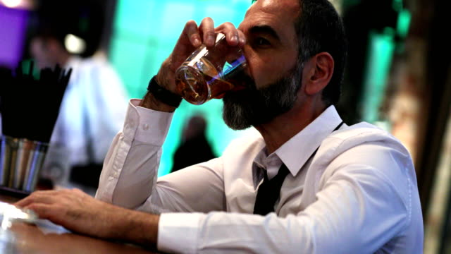 man having a drink in a bar. - bar counter stock videos & royalty-free footage