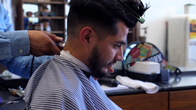 ms tu td man having back of neck trimmed while having hair cut in barber shop - mirror stock videos & royalty-free footage