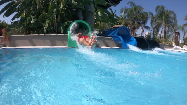 man having fun and sliding down in a water slide - water slide stock videos & royalty-free footage