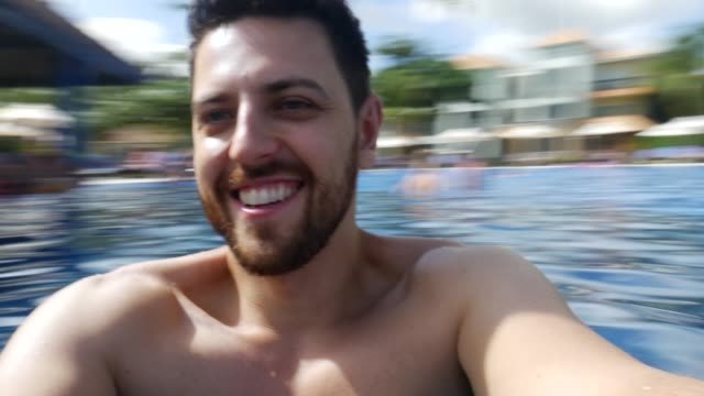 man having fun on the swimming pool - spinning stock videos & royalty-free footage