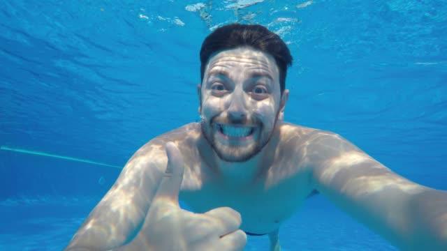 man having fun underwater - thumbs up stock videos & royalty-free footage