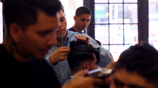 ms man having hair cut in barber shop - barber chair stock videos & royalty-free footage