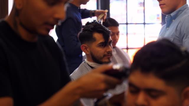 ms man having hair cut in barber shop - hair clipper stock videos & royalty-free footage