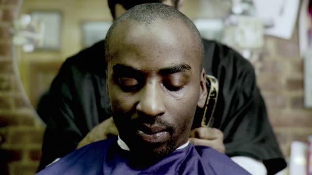 CU Man having haircut done at barbershop, Brooklyn, New York City, New York State, USA