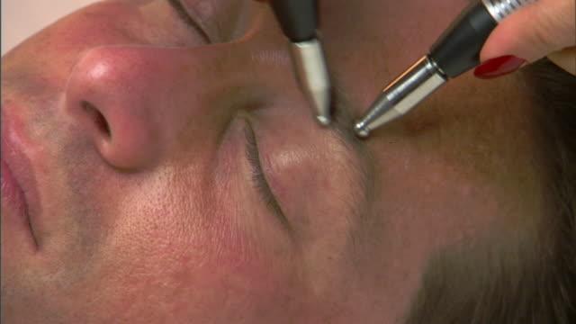 ECU, ZO, Man having micro-current wrinkle reducing treatment