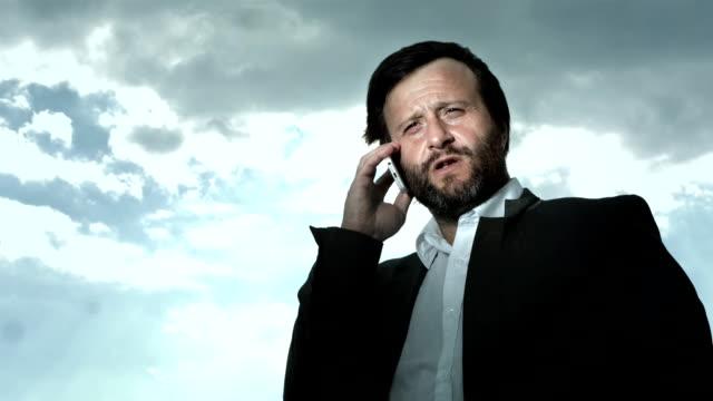 hd: man having serious conversation on phone - organized crime stock videos & royalty-free footage