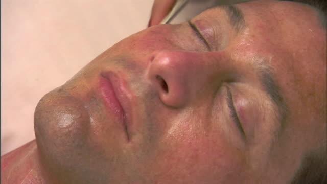 ecu, zo, man having skin rejuvenation treatment - spa treatment stock videos & royalty-free footage