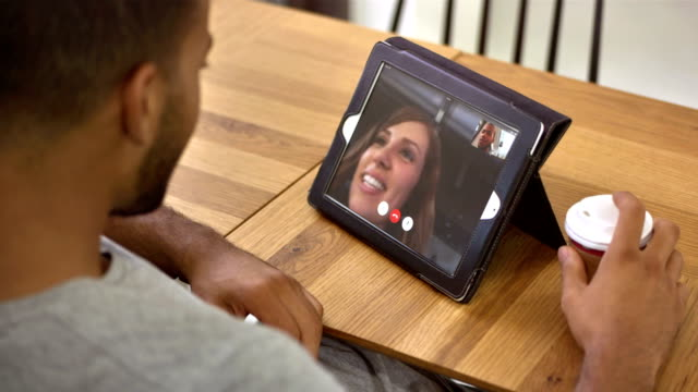 ms man having video call on digital tablet - boyfriend stock videos & royalty-free footage