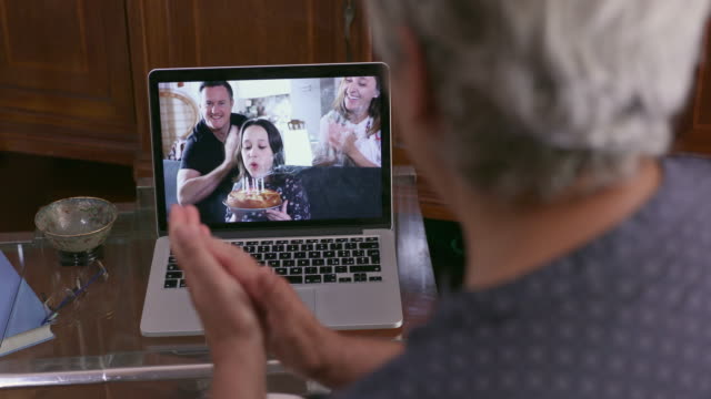 man having video call with family - italy stock videos & royalty-free footage