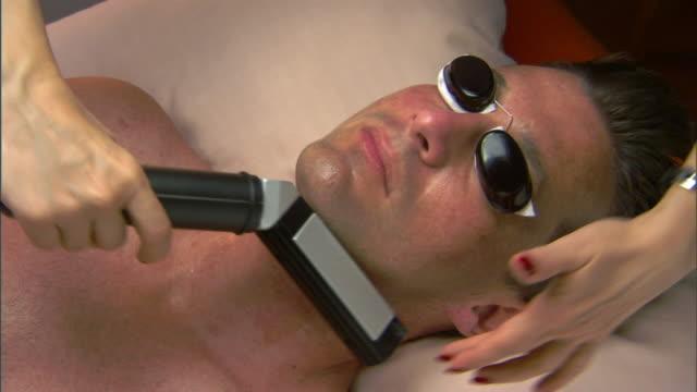 ZO, CU,  HA, Man having VIP flash pulse-light skin rejuvenation treatment