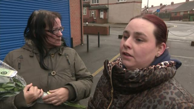 man held by police over murder of leonie weeks in rotherham england yorkshire rotherham dinnington ext family and friends leaving flowers at scene... - south yorkshire stock videos and b-roll footage
