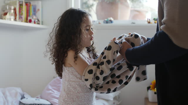 man helping girl to put on spotted dress - single father stock videos & royalty-free footage
