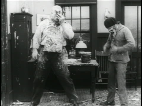 b/w 1916 man hiding behind table during pie fight men throwing pies / 2 shots - 1916 stock videos & royalty-free footage