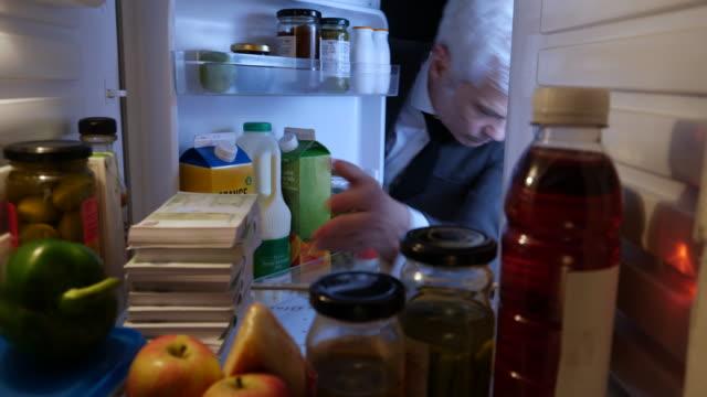 pov man hiding stacks of euros in a fridge - ebenezer scrooge stock videos & royalty-free footage