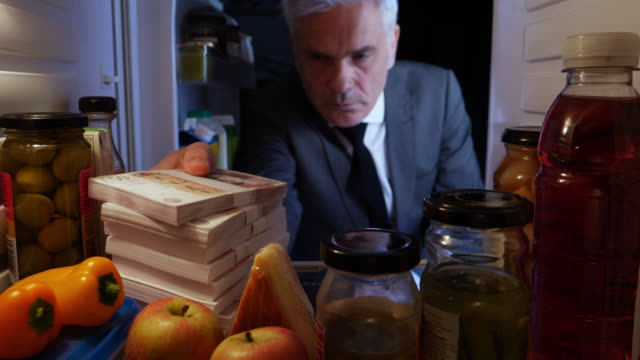 pov man hiding stacks of uk pounds in a fridge - hiding stock videos & royalty-free footage