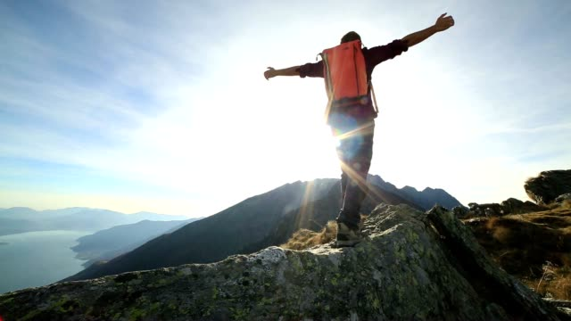 man hiker walking on mountain ridge crest - mountain peak stock videos and b-roll footage