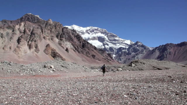 man hiker walking to the aconcagua mountain summit - argentina stock videos & royalty-free footage
