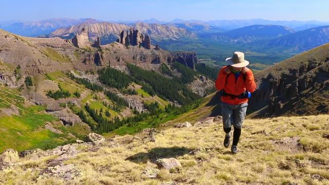 man hikes on mountain ridge top - gunnison stock videos & royalty-free footage