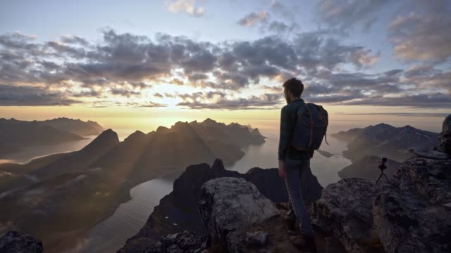 man hiking  in mountains  on senja island in fog - panoramic stock videos & royalty-free footage