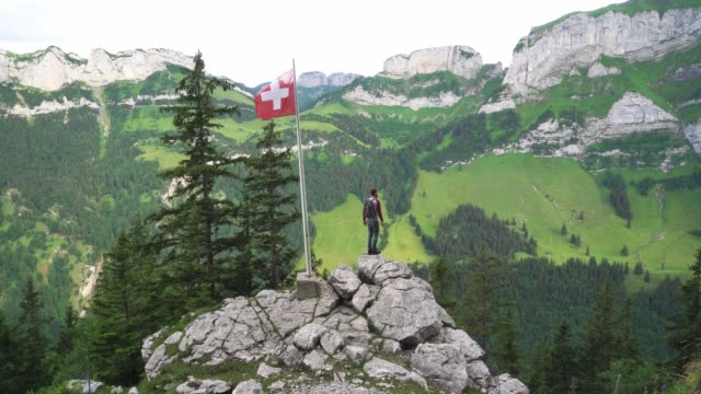 man hiking in swiss alps in appenzell - national flag stock videos & royalty-free footage