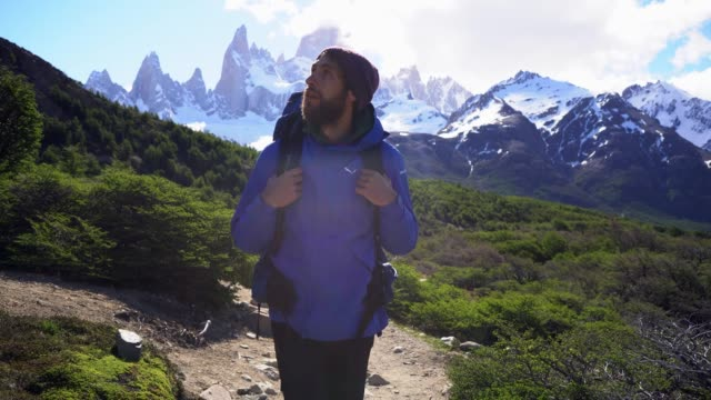 man hiking near  fitz roy mountain in patagonia - unesco world heritage site stock videos & royalty-free footage