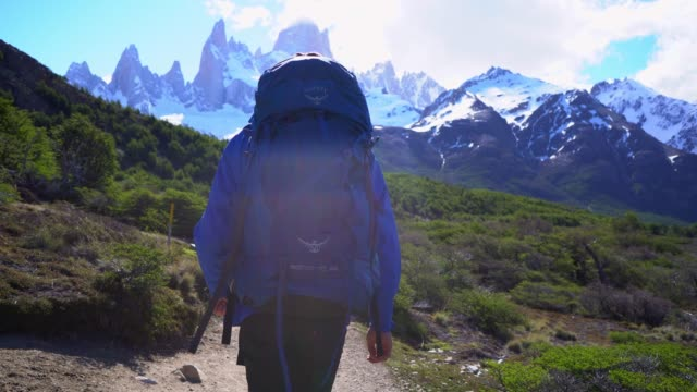 man hiking near  fitz roy mountain in patagonia - snowcapped mountain stock videos & royalty-free footage
