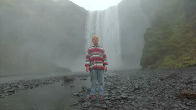 a man hiking near skogafoss waterfall in iceland, europe. - slow motion - goodsportvideo stock videos and b-roll footage