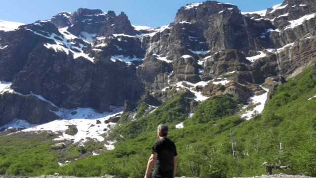 man hiking next to mount tronador base, patagonia argentina - horizontal stock videos & royalty-free footage