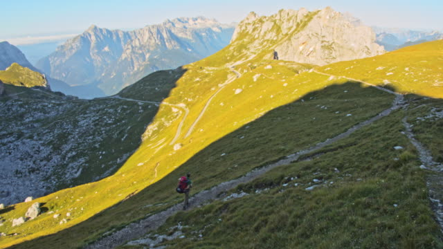 ws man hiking on a mountain path in the julian alps - julian alps stock videos and b-roll footage