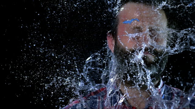 slo mo man hit in face with water balloon - spray stock videos & royalty-free footage