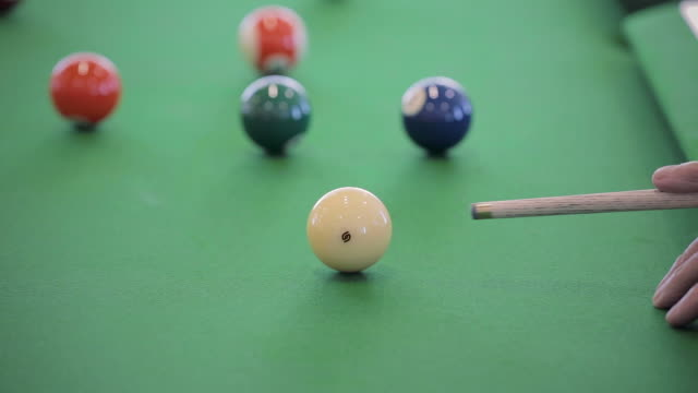 man hits cue ball on a pool table - close up - cue ball stock videos & royalty-free footage