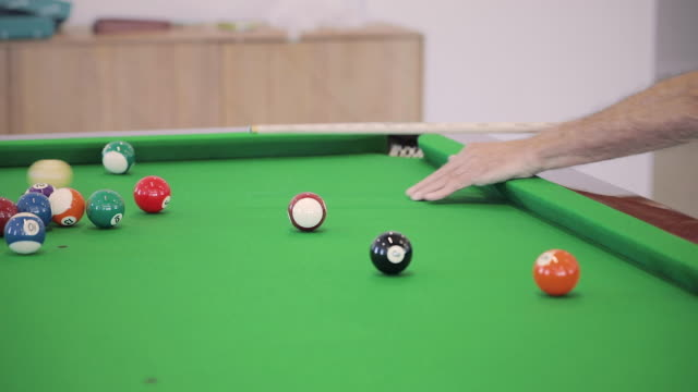 man hits cue ball on a pool table - mid shot - cue ball stock videos & royalty-free footage