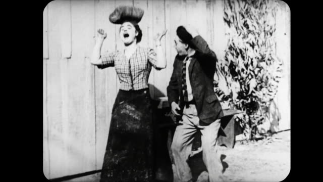 1914 man hits woman with rock and punches her in the face while trying to attack her boyfriend - 1914 stock videos & royalty-free footage