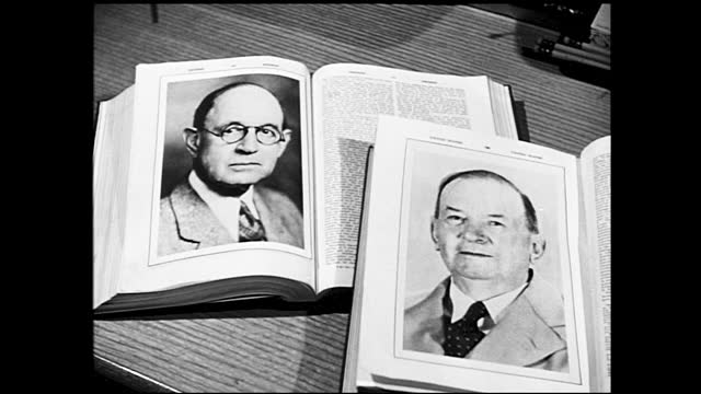 man hitting crystal with small hammer; man in suit walking and flipping through a book; book open on the table with photograph of an elder man with... - 1940 1949 bildbanksvideor och videomaterial från bakom kulisserna