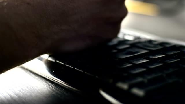slo mo man hitting his keyboard - enter key stock videos & royalty-free footage