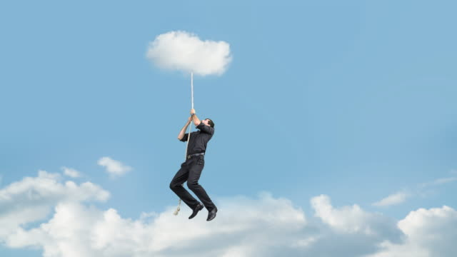Man hold on to rope attached to the cloud