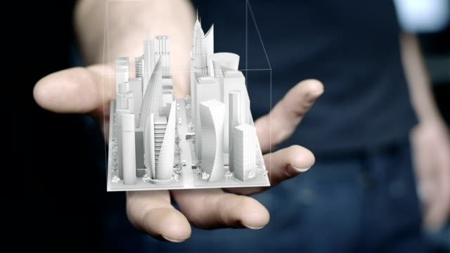 man holding 3d city hologram in his hand - digital animation stock videos & royalty-free footage