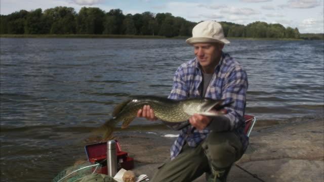 A man holding a big pike Sweden.