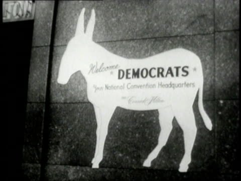 man holding a flag with a donkey on it / sign with a donkey on it / man leading a live donkey down a street - 1956 stock videos & royalty-free footage