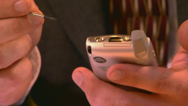 Man  holding a PDA handheld shot