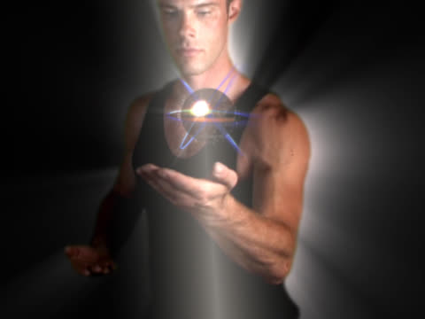 man holding ball of energy in palm of hand - digital enhancement stock videos & royalty-free footage